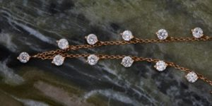 diamond-necklace-on-marble@2x